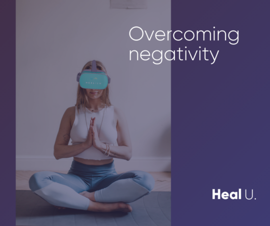 woman wearing an oculus go headset with text overlay that reads overcoming negativity
