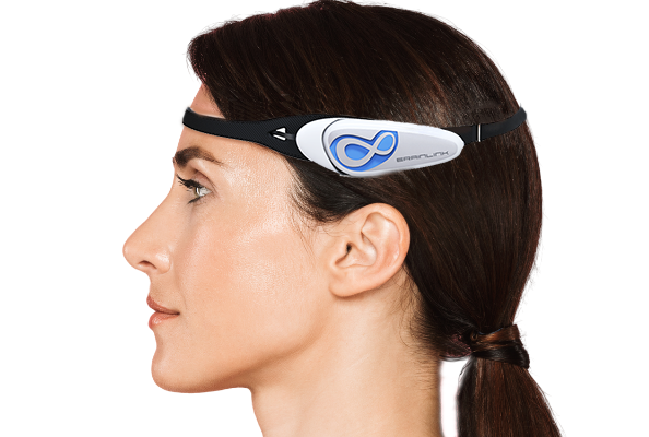 woman wearing a BrainLink headband