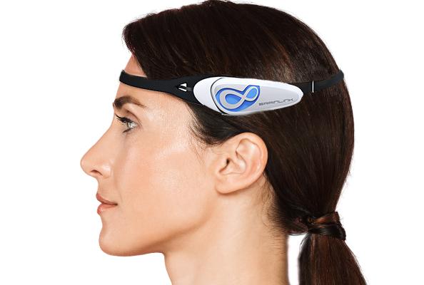 woman wearing a BrainLink headband