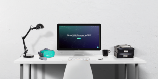 A desktop with an Oculus Go headset and computer