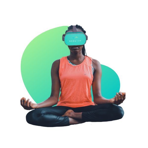 woman sitting cross legged with vr goggles