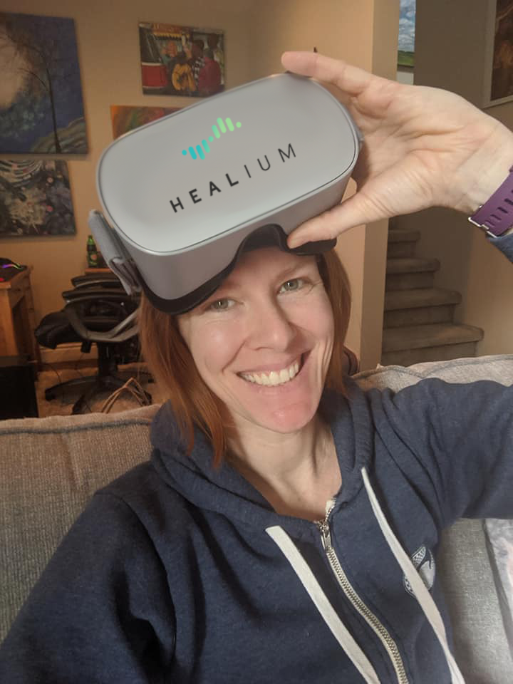 Heather wears an Oculus Go headset with the Healium logo displayed