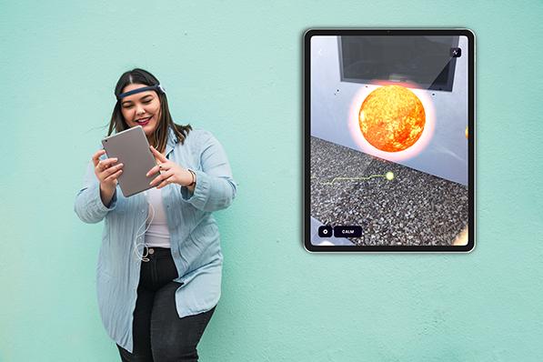 woman with BrainLink on ipad using Healium