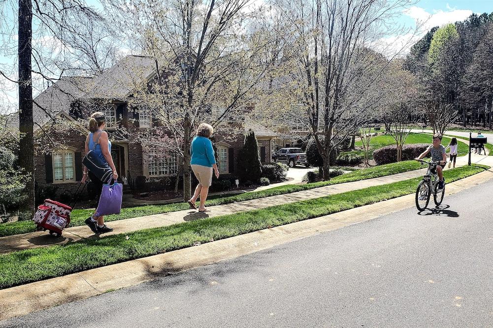 family walking in the neighborhood